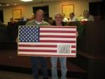 Alderman McHugh presents Sam Nicastro of Fairplay with a framed American flag